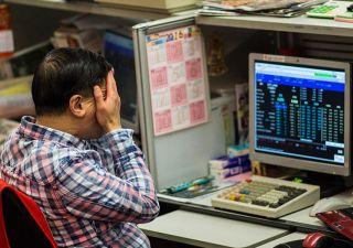 Mercati assediati da guerra valutaria, la chiave è il cross dollaro yuan