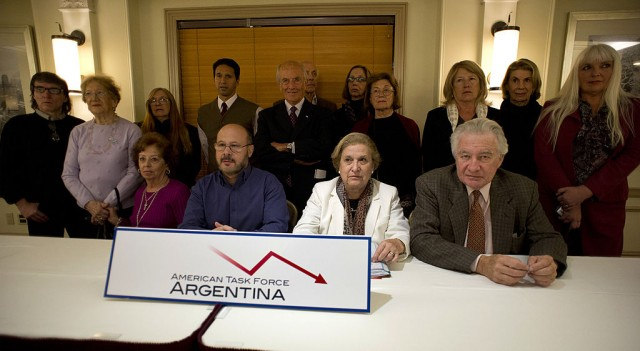 Argentine pensioners gather for a photo after a news conference, regarding Argentina's failure to meet bond payments, January 29, 2013 in New York. The group is in New York on a visit organized by the American Task Force Argentina to decry the Kirchner regime's refusal to honor the country's ongoing debt obligations