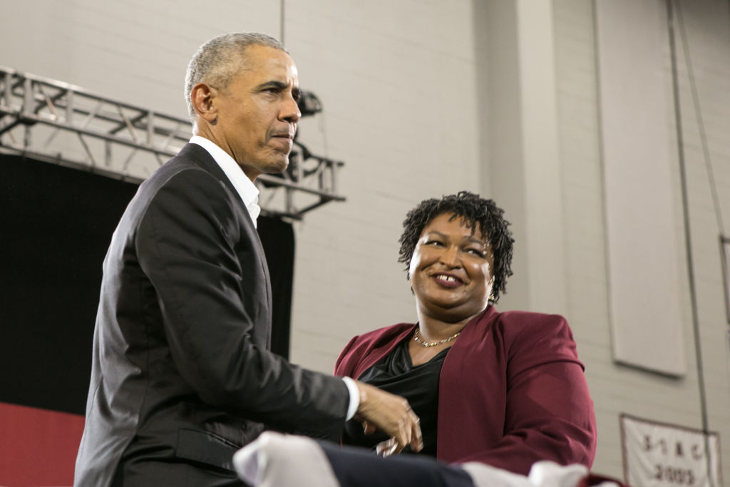 L'ex presidente Usa Barack Obama in compagnia della candidata al posto di governatore della Georgia, la Democratica Stacey Abrams.